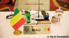 An empty seat of the Mali representative is seen in Accra, Ghana on September 16, 2021, at the Economic Community of West African States (ECOWAS) Extraordinary meeting on the political situation in Guinea. - Leaders from the western African bloc ECOWAS were meeting on September 16, 2021 to decide on measures to bring Guinea back to constitutional rule after troops ousted President Alpha Conde in a coup this month. (Photo by Nipah Dennis / AFP)