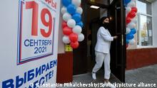 6652784 17.09.2021 A woman leaves a polling station in Simferopol, Crimea, Russia. Russia holds legislative elections on 17-19 September 2021. Voters will elect members of the Russian State Duma and heads of nine Russian regions and 39 constituent regions. Konstantin Mihalchevskiy / Sputnik
