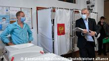 6652785 17.09.2021 Head of the Republic of Crimea Sergei Aksyonov holds his ballot at a polling station during parliamentary elections, in Simferopol, Crimea, Russia. Russia holds legislative elections on 17-19 September 2021. Voters will elect members of the Russian State Duma and heads of nine Russian regions and 39 constituent regions. Konstantin Mihalchevskiy / Sputnik