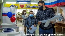 A man prepares to cast his ballot at a polling station in Yakutsk, Russia
