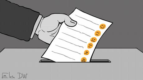 Карикатура Сергея Елкина - рука бросает в избирательную урну бюллетень с различными эмодзи.