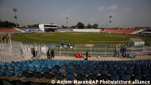 Pakistani police officers stand guard an enclosure of the Pindi Cricket Stadium before the stat of the first one day international cricket match between Pakistan and New Zealand at the Pindi Cricket Stadium, in Rawalpindi, Pakistan, Friday, Sept. 17, 2021. The limited-overs series between Pakistan and New Zealand has been postponed due to security concerns of the Kiwis. (AP Photo/Anjum Naveed)