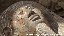 The face of an ancient wooden coffin, shaped like a human body that dates back to the 26th Pharaoh Dynasty that ruled from 672 BC to 525 BC, is seen in Sakkara, south of Cairo Wednesday, March 2, 2005. Australian archaeologists have discovered one of the best preserved ancient Egyptian mummies dating from about 2,600 years ago, Zahi Hawass, the head of Egypt's Supreme Council for Antiquities said.(AP Photo/Amr Nabil)