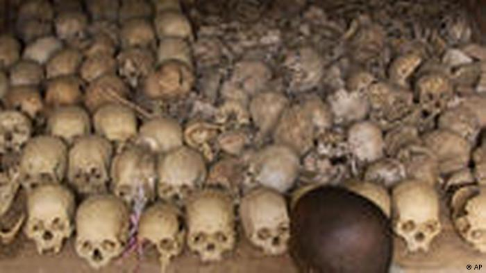 A man looks at hundreds of skulls at a memorial for victims of the 1994 genocide in Rwanda. (AP Photo/Saurabh Das