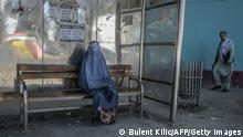 15.09.21 *** TOPSHOT - A burqa-clad woman waits for transportation at a bus stop in Kabul on September 15, 2021. (Photo by BULENT KILIC / AFP) (Photo by BULENT KILIC/AFP via Getty Images)