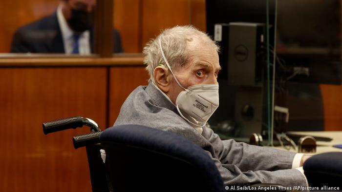 Robert Durst wears a mask while sitting in court in California