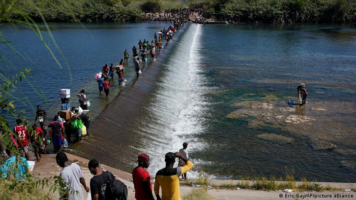 Haitian migrants use a dam to cross to and from the United States from Mexico in Del Rio, Texas