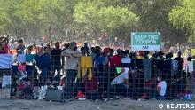 Migrants stand by the International Bridge between Mexico and the U.S., in Del Rio, Texas, U.S., September 16, 2021, in this picture obtained from social media. Picture taken September 16, 2021. OFFICE OF U.S. CONGRESSMAN TONY GONZALES (TX-23)/via REUTERS THIS IMAGE HAS BEEN SUPPLIED BY A THIRD PARTY. MANDATORY CREDIT. NO RESALES. NO ARCHIVES.