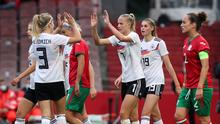 Kathrin Hendrich, Lea Schüller and Jule Brand celebrate one of Germany's goals against Bulgaria