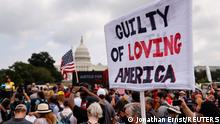 A sign is held during a rally in support of defendants being prosecuted in the January 6 attack on the U.S. Capitol, in Washington, D.C., U.S., September 18, 2021. REUTERS/Jonathan Ernst