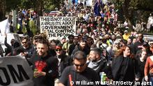 Protesters march through the streets during an anti-lockdown rally in Melbourne on September 18, 2021. (Photo by William WEST / AFP) (Photo by WILLIAM WEST/AFP via Getty Images)