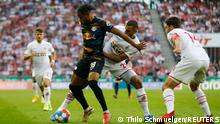 Soccer Football - Bundesliga - FC Cologne v RB Leipzig - RheinEnergieStadion, Cologne, Germany - September 18, 2021 RB Leipzig's Christopher Nkunku in action with FC Cologne's Ellyes Skhiri REUTERS/Thilo Schmuelgen DFL regulations prohibit any use of photographs as image sequences and/or quasi-video.