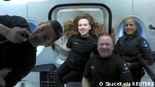 Inspiration4 crew Jared Isaacman, Sian Proctor, Hayley Arceneaux, and Chris Sembroski, seen on their first day in space in this handout photo released on September 17, 2021. SpaceX/Handout via REUTERS NO RESALES. NO ARCHIVES. THIS IMAGE HAS BEEN SUPPLIED BY A THIRD PARTY. MANDATORY CREDIT TPX IMAGES OF THE DAY