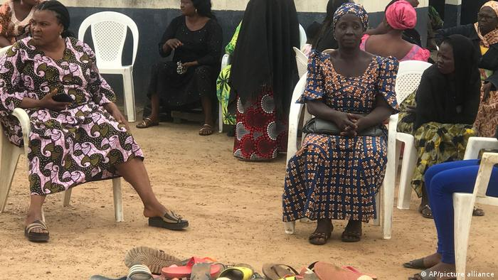 Parents of abducted schoolchildren wait for the return of their family members.
