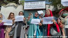"""KABUL, AFGHANISTAN - SEPTEMBER 19: Afghan women activists gathered to protest against Taliban restrictions, who were seen calling for rights and justice in front of the former ministry of women affairs which was setting up as a ministry for the """"propagation of virtue and the prevention of vice"""" by the Taliban in Kabul, Afghanistan-September 19, 2021. Haroon Sabawoon / Anadolu Agency"""