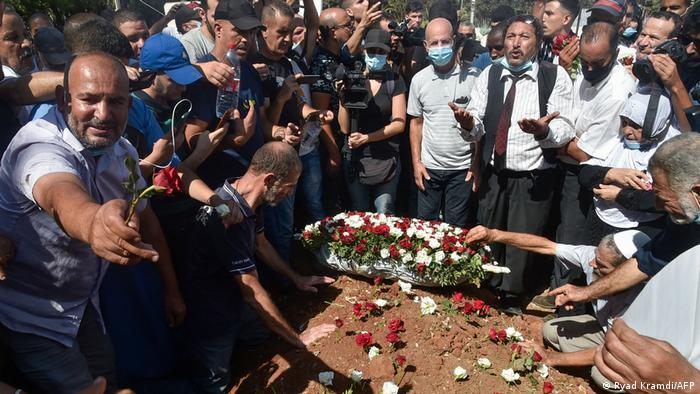 Algerians place roses on the tomb of former President Abdelaziz Bouteflika during his funeral