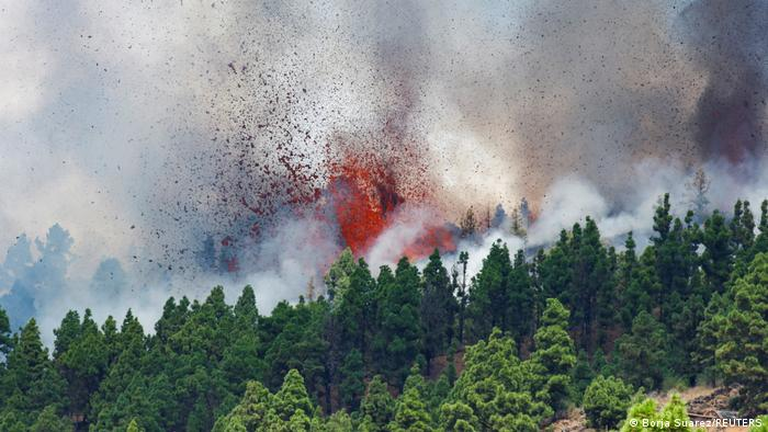 Lava and ash ejected from side of mountain