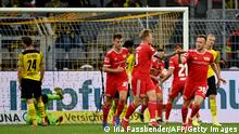 Union Berlin's German forward Andreas Voglsammer (C) celebrates with Union Berlin's German forward Cedric Teuchert (R) after scoring the 3-2 during the German first division Bundesliga football match Borussia Dortmund vs FC Union Berlin on September 19, 2021 in Dortmund, western Germany. - DFL REGULATIONS PROHIBIT ANY USE OF PHOTOGRAPHS AS IMAGE SEQUENCES AND/OR QUASI-VIDEO (Photo by Ina Fassbender / AFP) / DFL REGULATIONS PROHIBIT ANY USE OF PHOTOGRAPHS AS IMAGE SEQUENCES AND/OR QUASI-VIDEO (Photo by INA FASSBENDER/AFP via Getty Images)