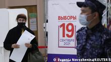 A woman walks to cast her ballot at a polling station on the last day of three-day long parliamentary elections in Moscow, Russia September 19, 2021. REUTERS/Evgenia Novozhenina