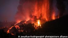 EL PASO, SPAIN - SEPTEMBER 19: Mount Cumbre Vieja erupts in El Paso, spewing out columns of smoke, ash and lava as seen from Los Llanos de Aridane on the Canary island of La Palma on September 19, 2021. - The Cumbre Vieja volcano erupted on Spain's Canary Islands today spewing out lava, ash and a huge column of smoke after days of increased seismic activity, sparking evacuations of people living nearby, authorities said. Cumbre Vieja straddles a ridge in the south of La Palma island and has erupted twice in the 20th century, first in 1949 then again in 1971. Andres Gutierrez / Anadolu Agency