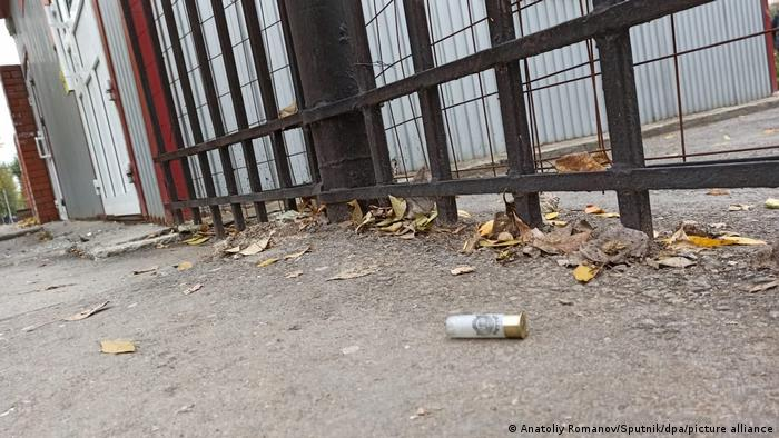 Cartridge lying on ground in front of building