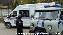 6655235 20.09.2021 Police and rescue service cars are parked in a street, in Perm, Russia. Four persons were injured and some students and lecturers managed to lock themselves in classrooms during a shooting from some non-lethal weapons at the state university in Perm. Anatoliy Romanov / Sputnik
