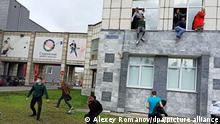 6655245 20.09.2021 Students jump from windows of Perm State National Research University during a shooting, in Perm, Russia. According to preliminary information Some people were killed and others injured during a shooting at the Perm State National Research University. Alexey Romanov / Sputnik