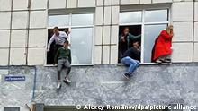 6655257 20.09.2021 Students jump from windows of Perm State National Research University during a shooting, in Perm, Russia. According to preliminary information some people were killed and others injured during a shooting at the Perm State National Research University. Alexey Romanov / Sputnik