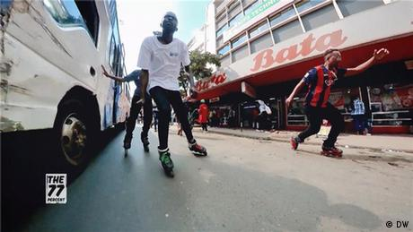 Young men inline skate on the asphalt in front of the Bata shoe store in Nairobi