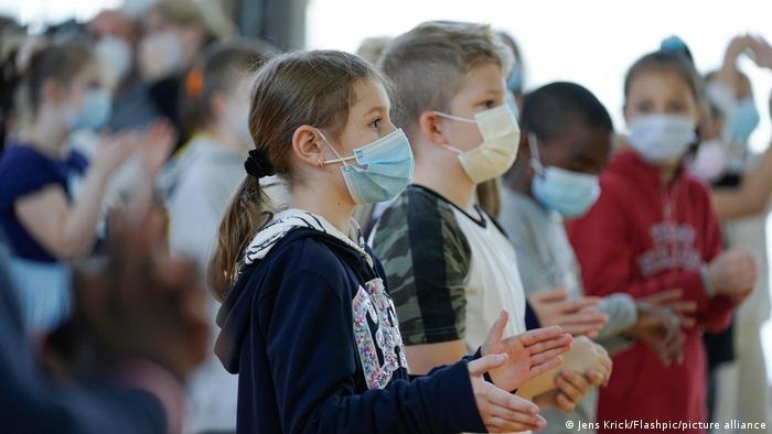 Primary school children wearing masks