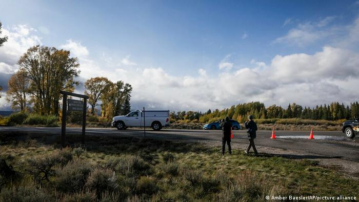 A coroner's vehicle drives away in the Spread Creek area of the Bridger-Teton National Forest