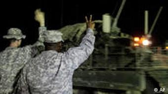Soldiers waving colleagues goodbye