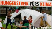 Climate activists pictured near a protest tent camp in Berlin