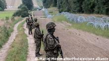 Defence minister Mariusz Blaszczak said more soldiers would be sent and a fence 2.5 metres tall would be erected along most of the 150-kilometre border, with construction due to begin next week. Polish army soldier in front of border between Poland and Belarus. On August 26, 2021 at Border Poland-Belarus. (Photo by Maciej Moskwa/NurPhoto)
