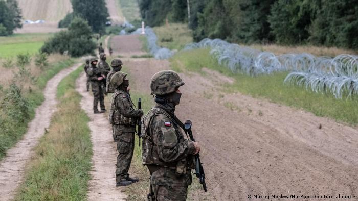 Soldiers stand in line at the Poland-Belarus border