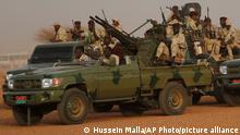 22.06.2019 Sudanese soldiers from the Rapid Support Forces unit which led by Gen. Mohammed Hamdan Dagalo, the deputy head of the military council, secure the area where Dagalo attends a military-backed tribe's rally, in the East Nile province, Sudan, Saturday, June 22, 2019. Sudan's protest leaders say they are meeting with an Ethiopian envoy over proposals to resume negotiations with the ruling military council. (AP Photo/Hussein Malla)