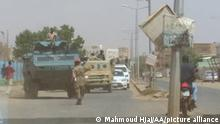 21.09.2021 QHARTOUM, SUDAN - SEPTEMBER 21: Sudanese soldiers block the road for taking precautions affter a failed coup attempt in Qhartoum, Sudan on September 21, 2021. State television said that coup attempt was taking place in the country, calling on the citizens to confront it. This came in urgent news broadcast by the state TV, without giving further details about the group behind the plot. Mahmoud Hjaj / Anadolu Agency