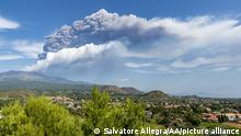 CATANIA, ITALY - SEPTEMBER 21: Mount Etna volcano spews smoke as seen from Treacastagni on September 21, 2021 in Catania, Italy three weeks after the last eruptive event. Once again, the Southeast Crater erupted, the highest jets of the lava fountain have reached 500 meters, the column of ash and gas has exceeded nine kilometers in height and the heavy rain of ash fell on the villages on the east side of the volcano. This is the fifty-third eruptive episode in 2021, such a large series of eruptions in such a short period of time had not happened for 20 years. Salvatore Allegra / Anadolu Agency