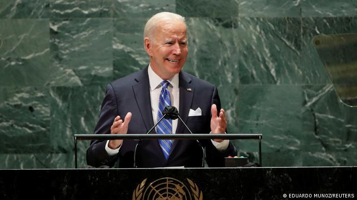 Joe Biden gestures with both hands