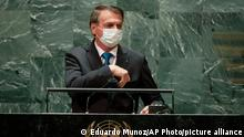 Brazil's President Jair Bolsonaro wears a protective face mask as he gets set to address the 76th Session of the U.N. General Assembly, Tuesday, Sept. 21, 2021, at United Nations headquarters in New York. (Eduardo Munoz/Pool Photo via AP)