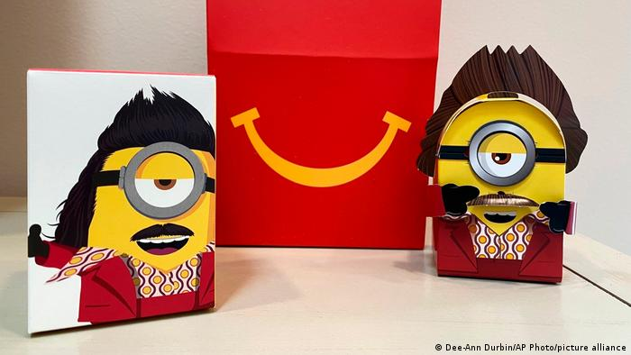 A cardboard McDonald's Happy Meal toy is shown with a Happy Meal box