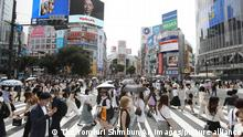 People wearing face masks are seen at Shibuya Scramble Crossing in Shibuya Ward, Tokyo in Tokyo on June 20, 2021, amid a pandemic of the new coronavirus COVID-19. A state of emergency will be lifted from on June 21 in Tokyo. ( The Yomiuri Shimbun via AP Images )
