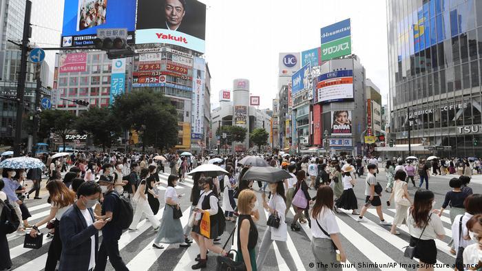 People wearing face masks are seen at Shibuya Scramble Crossing in Shibuya Ward, in Tokyo, June 20, 2021.