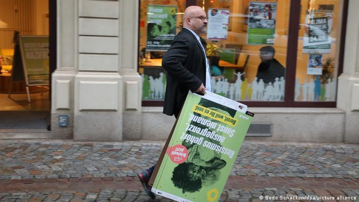 Wolfgang Wetzel, top candidate for the Green Party, walks through the city center with election posters