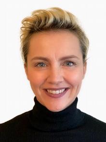 Die Opernsängerin Kristine Funkhauser lächelt