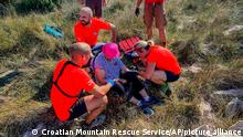 Croatia's Mountain Rescue Service pictured assisting the woman on the island of Krk