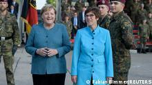German Chancellor Angela Merkel and German Defence Minister Annegret Kramp-Karrenbauer attend a military swear in ceremony of German army Bundeswehr, in Seedorf, Germany September 22, 2021. REUTERS/Fabian Bimmer