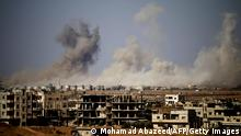 Smoke rises above a rebel-held town east of the city of Daraa during airstrikes by Syrian regime forces on June 30, 2018