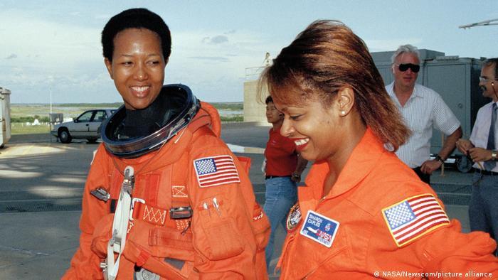 Mae Jemison (left) and Sharon McDougle, a spacesuit technician, photographed in 1992