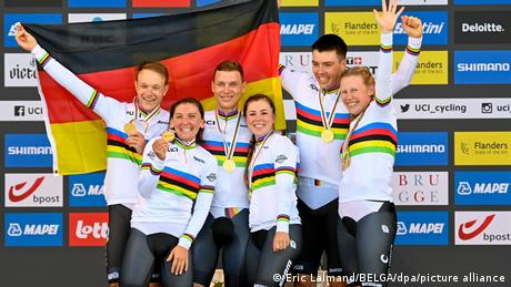 Germany's mixed relay cycling team celebrates winning gold at the world championships